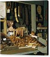 Vendor Holds Up Sausages For Young Girl Canvas Print