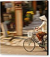 Vietnamese Woman Riding A Bicycle Canvas Print
