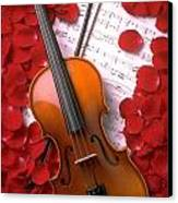 Violin On Sheet Music With Rose Petals Canvas Print by Garry Gay