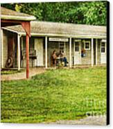 Waiting By The General Store Canvas Print by Paul Ward