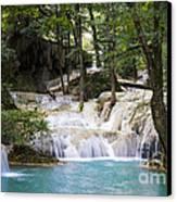 Waterfall In Deep Forest Canvas Print by Setsiri Silapasuwanchai