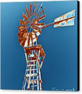 Windmill Rust Orange With Blue Sky Canvas Print by Rebecca Margraf