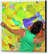 Woman Adjusting A Painting Canvas Print by Sami Sarkis
