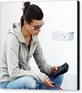 Woman Doing Diy Canvas Print by Carlos Dominguez