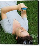 Woman Using Her Iphone Canvas Print by Photo Researchers, Inc.