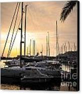Yachts At Sunset Canvas Print by Carlos Caetano