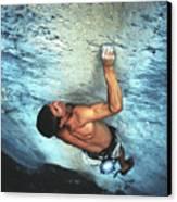 A Caucasian Man Rock Climbing Canvas Print by Bobby Model