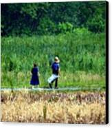 Amish Brother And Sister Canvas Print by Randy Matthews
