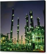 An Oil Refinery At Dusk Canvas Print by Lynn Johnson