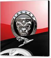 Black Jaguar - Hood Ornaments And 3 D Badge On Red Canvas Print by Serge Averbukh