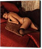 Sexy Young Woman Lying On A Bed Canvas Print