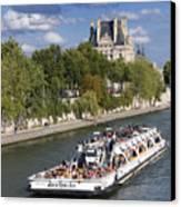 Sightseeing Boat On River Seine To Louvre Museum. Paris Canvas Print by Bernard Jaubert