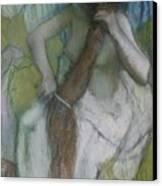 Woman Combing Her Hair Canvas Print by Edgar Degas