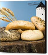 Different Breads And Windmill In The Background Canvas Print by Deyan Georgiev