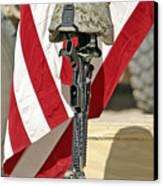 A Battlefield Memorial Cross Rifle Canvas Print by Stocktrek Images