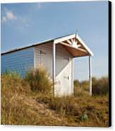 A Beach Hut In The Marram Grass At Old Hunstanton North Norfolk Canvas Print by John Edwards