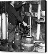 A Brewmeister Fills Kegs At A Bootleg Canvas Print by Everett