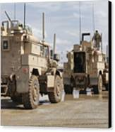 A Convoy Of Mrap Vehicles Near Camp Canvas Print