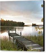 A Dock On A Lake At Sunrise Near Wawa Canvas Print by Susan Dykstra