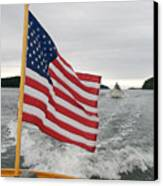 A Flag Waves On The Stern Of A Maine Canvas Print by Heather Perry