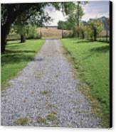 A Gravel Road Marks The Entranceexit Canvas Print