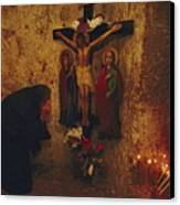 A Greek Pilgrim Prays In The Grotto Canvas Print by Annie Griffiths