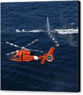A Helicopter Crew Trains Off The Coast Canvas Print by Stocktrek Images