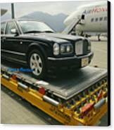 A Luxury Bentley Unloaded From An Canvas Print by Justin Guariglia