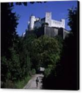 A Man Walks Toward The Salzburg Castle Canvas Print by Taylor S. Kennedy