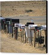 A Parade Of Mailboxes On The Outskirts Canvas Print by Stephen St. John