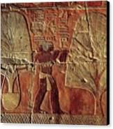 A Relief Of Men Carrying Myrrh Trees Canvas Print by Kenneth Garrett