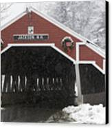 A Traditional Covered Bridge On A Snowy Canvas Print by Tim Laman