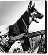 A Trained German Shepherd Sitting Watch Canvas Print by Everett