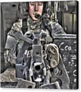 A Uh-60 Black Hawk Door Gunner Manning Canvas Print by Terry Moore