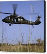 A U.s. Army Uh-60 Black Hawk Helicopter Canvas Print by Stocktrek Images