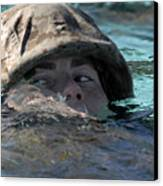 A U.s. Marine Swims Across A Training Canvas Print by Stocktrek Images