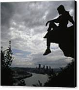 A Woman Perched On An Overlook Canvas Print by Lynn Johnson