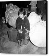 A Young Evacuee Of Japanese Ancestry Canvas Print by Stocktrek Images