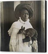 A Young Kenyan Woman Holds Her Pet Deer Canvas Print by Underwood And Underwood