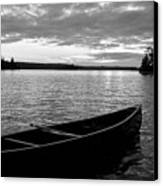 Abandoned Canoe Floating On Water Canvas Print