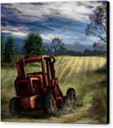 Abandoned Tractor Canvas Print by Ron Grafe