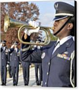 Airman Plays Taps During The Veterans Canvas Print by Stocktrek Images