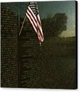 American Flag Left At The Vietnam Canvas Print by Medford Taylor