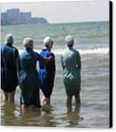 Amish Girls In The Surf Canvas Print