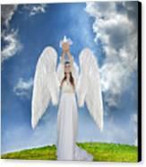 Angel Releasing A Dove Canvas Print by Jill Battaglia