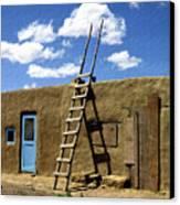 At Home Taos Pueblo Canvas Print by Kurt Van Wagner