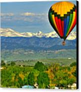 Ballooning Over The Rockies Canvas Print by Scott Mahon