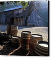 Barn And Wine Barrels Canvas Print by Kathy Yates