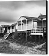Beach Huts North Norfolk Uk Canvas Print by John Edwards