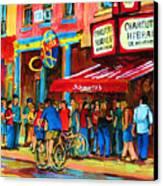 Biking Past The Deli Canvas Print